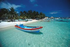 ISLA DE MUJERES Mexico...little island off cancun. take ferry, (20min, beautiful ride)...little shops, calm waters for swimming...affordable!