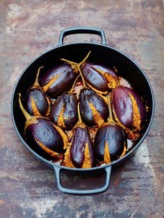 Baby Aubergines stuffed with Roasted Peanuts and Desiccated Coconut is a classic Gujarati recipe from Meera Sodha's Fresh India. This vibrant vegan main course is best served with a cucumber and mint raita, or with a salad, a dollop of yoghurt and rice. A quick and easy recipe perfect for a meat free Monday dinner.