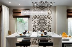 Candice Olson: Instead of brown paint, use shiny clear paint stencil on existing satin walls. Texture rather than colour
