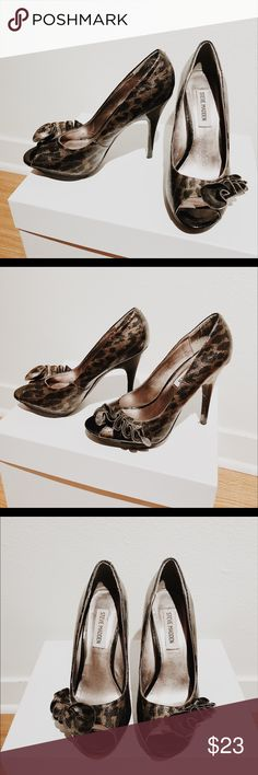 6.5 Steve Madden Heels with ribbon 6.5 Steve Madden heels that are 4.5 inches. They are dark brown and black in kind of an abstract animal print. There is a ribbon in front. Open toed. Half inch platform in front. Worn once for a wedding no visible scuffs. Steve Madden Shoes Heels