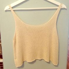 Brandy Melville Cream Knit Crop Top LEAVE OFFERS!! NOT SURE IF I WANT TO SELL!! not sure if this style has a name, but it is a knit top From brandy. worn a couple times, cut off the brandy tag because it was itchy leave an offer! will sell for a good price, close to retail. bought at the brandy store for $21 Brandy Melville Tops Tank Tops