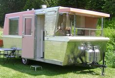 I love love love this pink and silver vintage trailer!