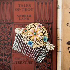 """filigree flower vintage hair comb, originally a 1940's brooch - """"The golden brooch - adorned with enamel painted flowers and diamante - has been reworked with loops of 1950's ivory pearls, gold wire, and a silver comb"""""""