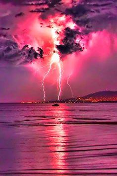 Lightning strike in big pink sky