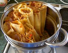 Mexican Pork Tamales: Tasty Street food from Mexico and Central America, spicy filling covered in corn dough and wrapped in a corn husk and steamed.
