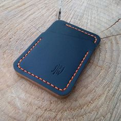 Left handed Speedwallet, black Chromexcel and orange thread. #handsewn #handmade #leatherwork #wallet #speedwallet #menstuff s#edc #everydaycarry #pocketdump