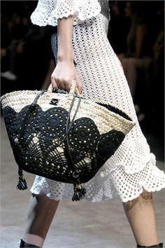 Valentino. crochet appliqued onto straw bag. I like it!