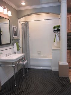 LOVE the overall look of this bathroom for girls bathroom.  Like the matte subway tile in vertical format. Love the black matte hex floor.  Love the black pencil trim.  Do NOT like the sink.  LOVE the fact the bathroom is in a neutral pallete of black and white which fits with A&C style homes.  For kids bathroom, would add in color through walls, shower curtain and tile.