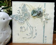 Marianne cut and emboss embossing folder.  Memory Box Vivianne and Darla butterfly die  Spellbinder Itty Bitty flower dies  SU tag punch  Craft Studio sentiment  Butterfly trail cut from Cheery Lynn Design die  Marianne dies backing flowers  Memory Box Tender leaves  Martha Stewart border punch  3 Say it in Crystals for embellishment  Ivory Linen paper  Paper from K paper stack