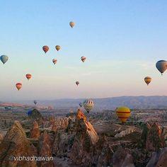 A sunrise hot air balloon ride over Göreme Valley in Cappadocia. Photo by @vibhadhawan.  #fodorsonthego #Turkey #hotairballoon #cappadocia