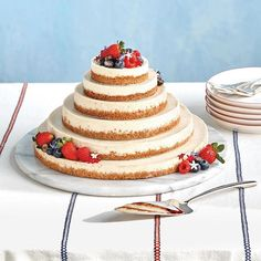 martha_weddings: Consider ending your night with a treat that will satisfy anyone with a savory or a sweet tooth. This six-tier fromage blanc cheesecake from New York Citys @lafayette380 is flavored with vanilla bean lemon zest and black pepper and baked atop an organic cornmeal crust. Blueberries and strawberries provide the finishing touch. : @georgebarberis   styling: @katiecovi   art direction: @lisengelhart   tablecloth: @heathertaylorhome   plates: @canvashomestore #marthaweddings