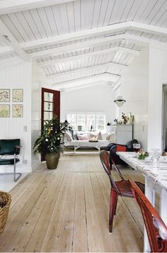 Whitewashed pine wood floors  I also love the beautiful roof:)