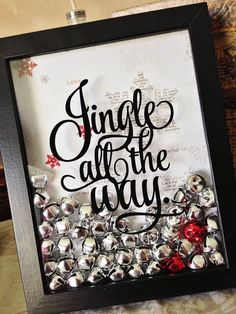 "Fill a shadow box with bells and print out ""Jingle all the way"" on paper if you don't want to pay for having it printed on glass!"
