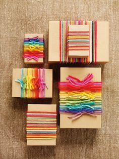 Rainbow yarn wrappings from More Last-Minute Knitted Gifts  via Melanie Falick Books
