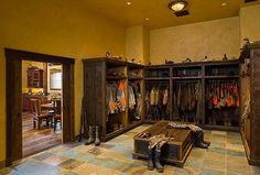 Montana mudroom...fishing gear, hunting gear, hiking gear, rock climbing gear, whitewater rafting gear, kayaking gear......great idea for a storage room or gun room