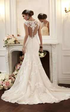Fall in love with this vintage-inspired Stella York wedding dress with perfectly framing lace shoulder straps. The lace racer-back detailing will make your exit amazing! # wedding