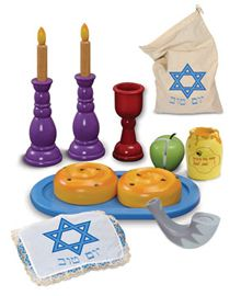 Kids love to create their own holiday fun with Kid Kraft's wooden playsets. The sturdy set includes two round Challahs with cloth cover, a shofar, an apple and honey jar, a Kiddush cup and candlesticks with candles; in a cloth drawstring bag. Dimensions: 15.5î x 11 x 10.75