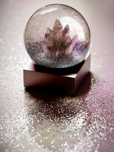 FP Crystal Snow Globe | Be captivated by the magical winter wonderland inside this snow globe. Features a crystal tower and glitter blizzard.     *By Free People