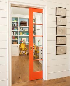 colorful home office with orange pocket door