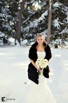 Ok, the white dress and the snow, with the dark trees and black wrap?  I am surprisingly in love with this.