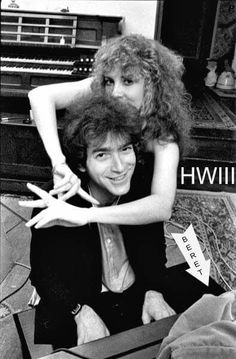 Stevie ☆♥❤♥☆ sending finger signals, or just fooling around with Benmont Tench, an American keyboardist best known as a founding member of Tom Petty and the Heartbreakers; https://en.wikipedia.org/wiki/Benmont_Tench