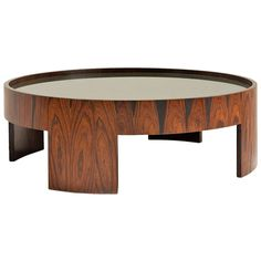 Round Coffee Table by Joaquim Tenreiro | From a unique collection of antique and modern coffee and cocktail tables at http://www.1stdibs.com/furniture/tables/coffee-tables-cocktail-tables/
