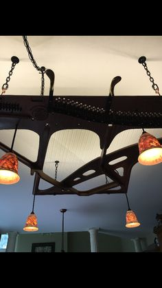 Repurposed piano harp into hanging art piece, lighting fixture and pot & pan holder. Contact me at bjgreen@hotmail.com if you would like one.