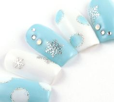 White and blue winter nail art design.