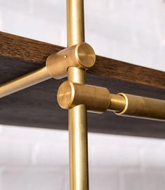 Solid brass machined components with mechanical connections can be easily adjusted to change shelf spacing.