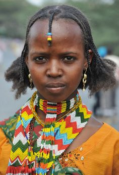 Ethiopian woman of Harari in Omo Valley in colorful dress