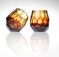 Cubism Amber colored, hand blown, cut and polished whiskey glasses.