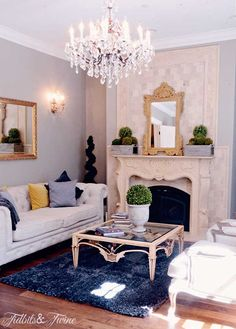 Love the beautiful chandelier and sconces in the room, think my family room needs the same.  Notice how chandelier is hung high so not to block the mirror.