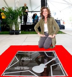 ♡♥Amy Grant 56 relaxes outside next to her star on April 27th,2017 and enjoys being inducted into the 'Music City Walk of Fame' in recognition of her significant contributions to Nashville and its musical heritage including being a six-time GRAMMY winner. Amy Grant's net worth is 55 million in 2018. The ceremony took place in Nashville's 'Walk of Fame Park' - click on pic to see a full screen pic in a better looking black background♥♡ Christian Music Artists, Christian Singers, Michael W Smith, Jesus Music, Amy Grant, Vince Gill, Country Music, Role Models, Black Backgrounds