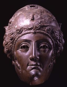 Bronze parade mask: a woman's face, perhaps worn by soldiers representing Amazons.