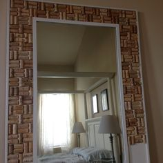 Custom made floor length mirror framed with wine corks!