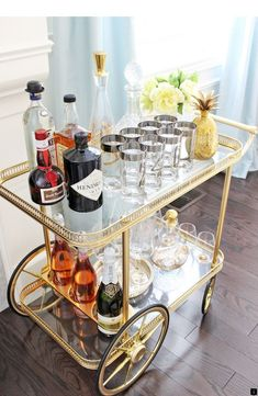 Bar Cart Ideas - There are some cool bar cart ideas which can be used to create a bar cart that suits your space. Having a bar cart offers lots of benefits. This bar cart can be used to turn your empty living room corner into the life of the party. Brass Bar Cart, Gold Bar Cart, Bar Cart Styling, Bar Cart Decor, Bandeja Bar, Bar Sala, Living Room Bar, Living Rooms, Bar Trolley