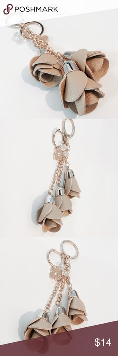 Tan Coming Up Roses Key Fob/ Bag Charm Pretty & unique! Tan and gold 'leather' three roses charm. Gold hardware with both key ring and bag charm closure. Accessories Key & Card Holders