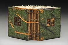Daniel Essig creates wood-covered art books and book-based sculptures. Using a fourth-century binding known as Ethiopian-style Coptic, he creates mixed-media book structures that incorporate unusual woods, handmade paper, found objects, fossils, and mica. http://danielessig.com HALF & HALF; mahogany, milk paint, handmade flax paper, linen thread, brass, leather, mica, fossils. Greek, Coptic and centipede bindings. 5 x 4 x 2.5""
