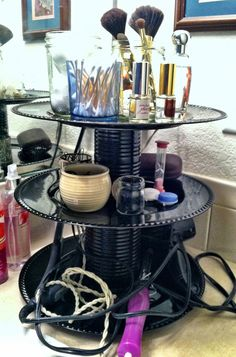 DIY Bathroom organizer made with vintage plates and soup cans