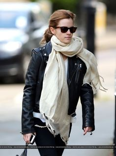 Emma Watson Wearing A Black Leather Bikers Jacket, White Top, Cream Scarf, Skinny Jeans And Nike Air Max Trainers Out In London On May, 14