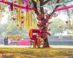 Rajasthani imbrellas, pink and yellow rickshw, kitsch decor , funky mehendi decor , unique mehendi decor ideas , colorful mehendi decor