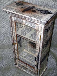 Decoupage newspaper cabinet