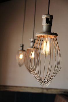 Hanging lights made from industrial mixer whisks
