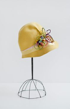 vintage 1920s yellow cloche with pipe adornment