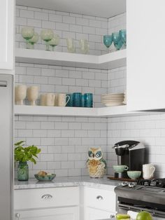 Small and Mighty White Kitchen : Rooms : HGTV Corner Top Shelves and bottom cabinets with deep drawers