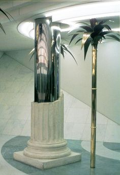 Hans Hollein - Travel Agency (Vienna) Greek Columns and Bronze palm trees in travel agency signifies cliche's associated with popular tourist destinations.