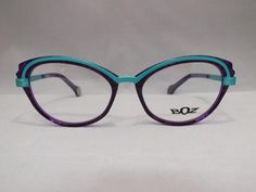 The stylish, sensual and gorgeously colored frames of the BOZ eyewear collections bestow originality and elegance on the women who wear them. Exploring cultural mixes and the influence of plants, the brand makes its mark using contemporary and original themes. Manufactured in France. 52-18-140 Color 7525 (Purple & Teal) Plastic Frame