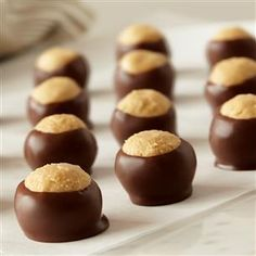 Ingredients for Buckeyes 1 & 1/2 cups creamy peanut butter 1 cup softened butter 1/2 teaspoon vanilla 6 cups confectioners' sugar 4 cups semi sweet chocolate chips     The Finished Product: