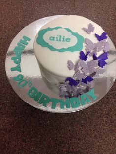Butterfly garden cake in purple and turquoise for a 90th birthday.
