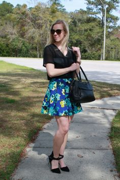 Wildflowers: cobalt blue floral skater skirt, black top, suede ankle-strap pumps, black Kate Spade bag